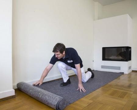 Thi công thảm bảo vệ sàn